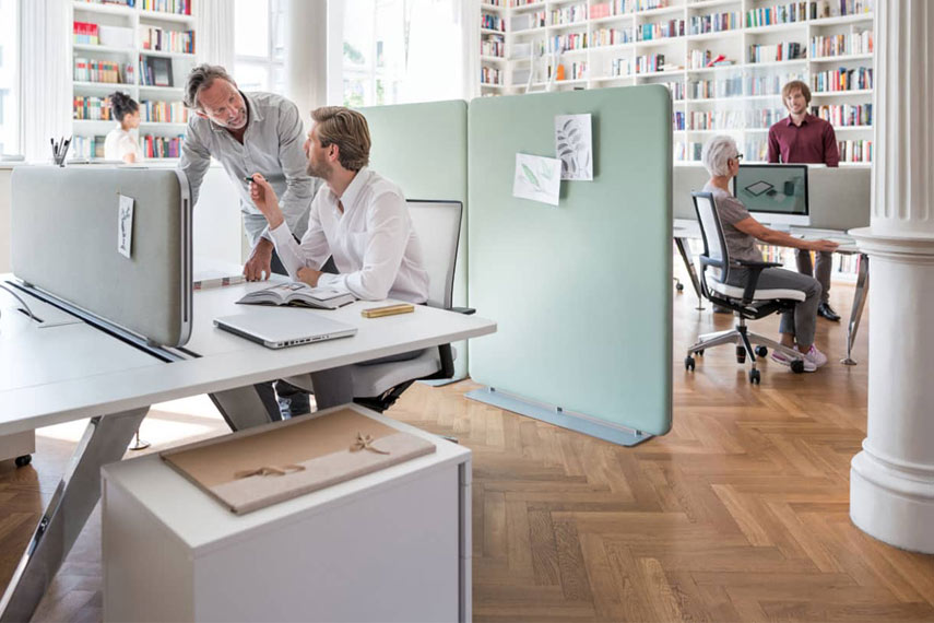Office workers using contemporary office furniture.