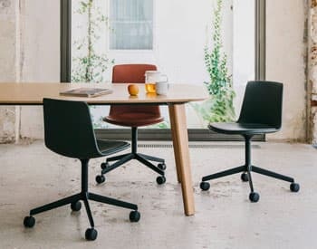 Mobile office chairs at meeting table