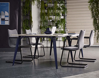 Cantilever chairs around table