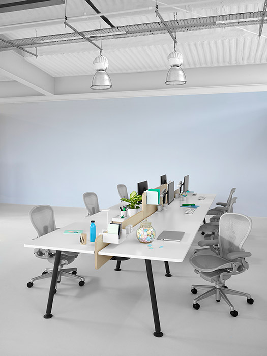 Light grey Aeron office chairs at Memo desk